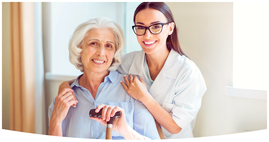 Smiling and cheerful senior women with her kind nurse
