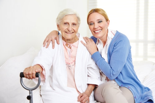 happy elderly woman with a caregiver